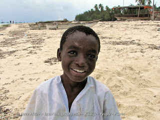 local boy on the beach in Zanzibar